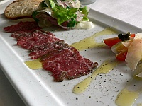 Beef Carpaccio with Orange-Olive Salsa and Shaved Cheese